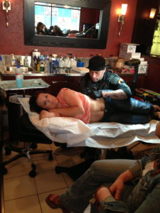 Tara getting an amazing tattoo